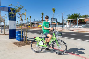 Hulu Breeze bike sharing rider in Santa Monica by the 17th Street Expo Station