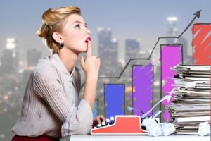 growing business graph and lady thinking