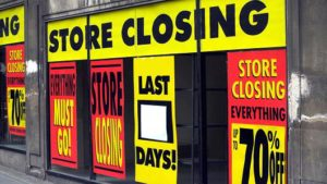 Store Closing - going out of business sign - failing brick and mortar business