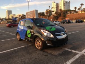 waive car sharing advertising Oscar - parked at the Santa Monica pier