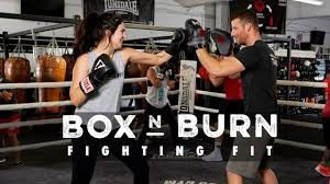 personal trainer training a client at box n burn santa monica